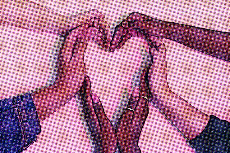 Six human hands, of different races, forming the shape of a heart.